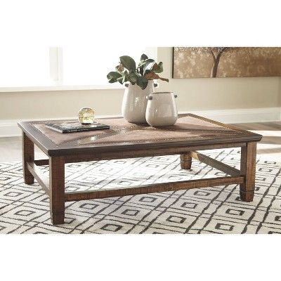 Royard Rectangular Cocktail Table Brown Signature Design By Ashley Coffee Table With Storage Coffee Table Images Table