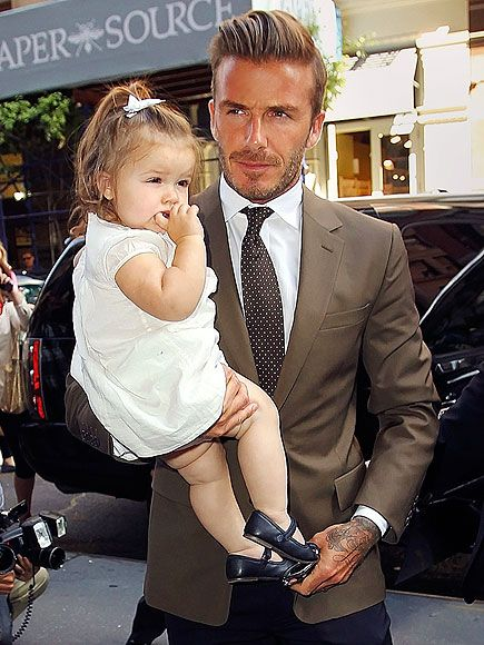 People.com -- High style runs in the family! David Beckham completes his outfit with a very special accessory – 14-month-old daughter Harper! – after taking in wife Victoria Beckham's runway show Sunday at New York Fashion Week.