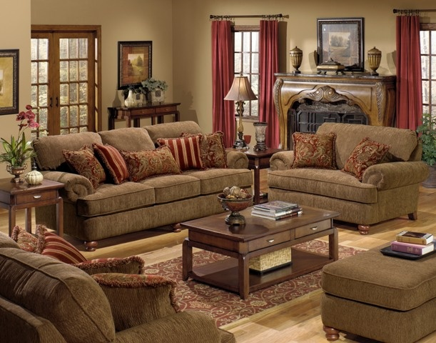 The Whitman Sofa offers traditional style with deep seating comfort that works well for informal relaxing and formal entertaining. The luxurious textured diamond motif umber chenille upholstery offers plush comfort that complements the four red and gold prints of the two accent pillows with fringe. A reversible box welted seat cushion, solid wood turned bun feet, and rolled arms round off this sophisticated look.
