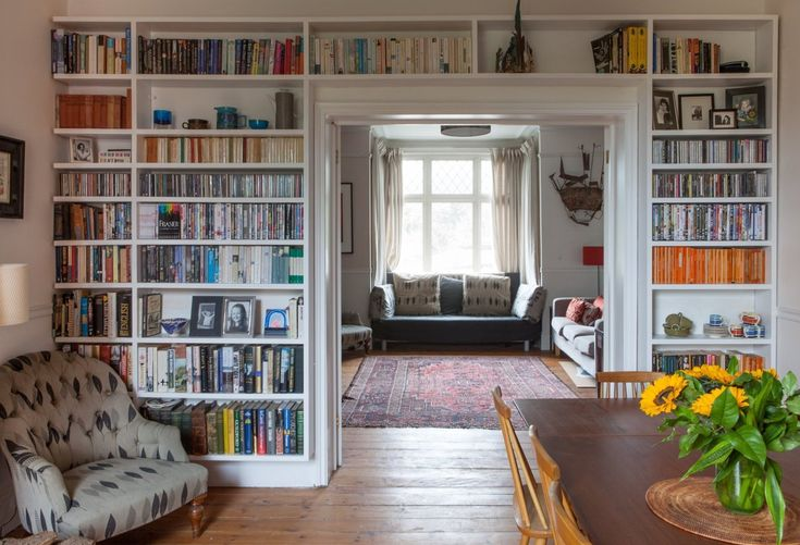 Diana & Dominic's Art-filled Victorian - epic built-in bookshelves, vintage rug, cool tufted chair