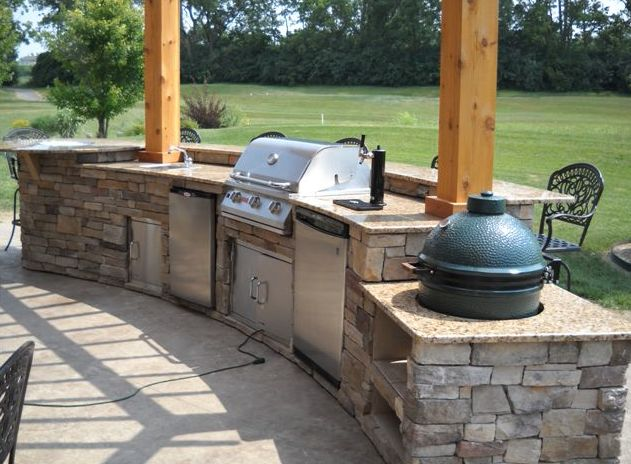 Golf course in the background of this beautiful open outdoor kitchen! The Big Green Egg built right in! Nice Keg-orator too!