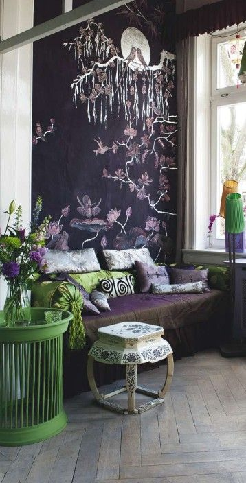 The Green And Purple Color Scheme Helps To Give The Room A Dark And Lively  Feel