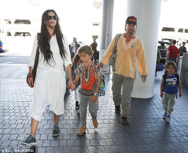 Boho bevy:Matthew McConaughey, 47, was spotted leaving LAX with his family on Tuesday...