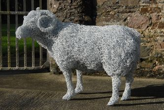 Ram, galvanised wire sculpture painted white. Private commission.