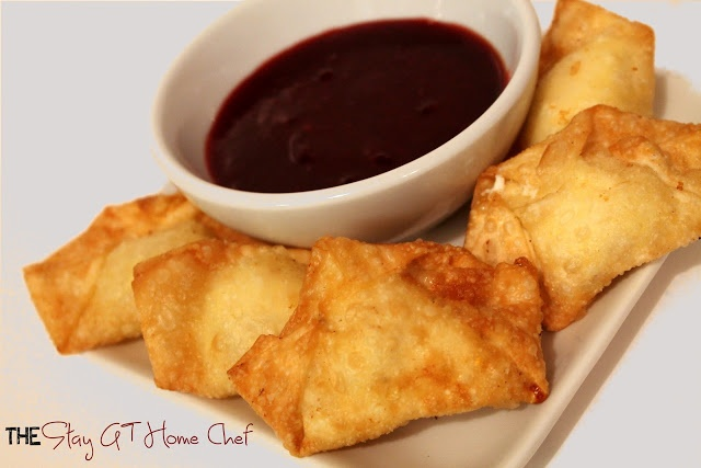 Cream Cheese Wontons with Cranberry Sweet and Sour Sauce. Awesome holiday party food!