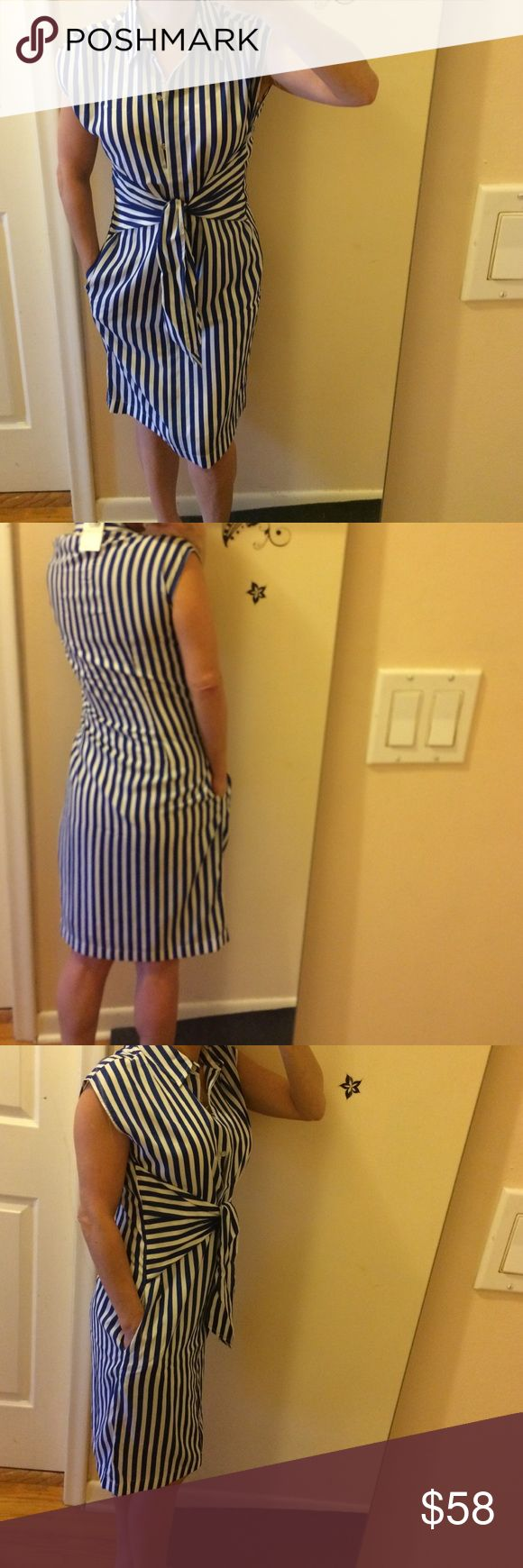 """BNWT nautica striped dress w/pockets. Sleeveless dress that ties at waist. Has pockets. Sleeveless Abd has extra button attached to tags. Bust: 17"""" arm holes: 7.5"""". Shoulders: 6.5"""".  Top of shoulder to bottom: 36"""" long. Made of polyester but a real smooth feel and look. A very crisp look for first impressions , or maybe you have a special event that you can really dress up with the right accessories. Retails 148$ plus all my buyers receive a free thank you  gift. Nautica Dresses Midi"""