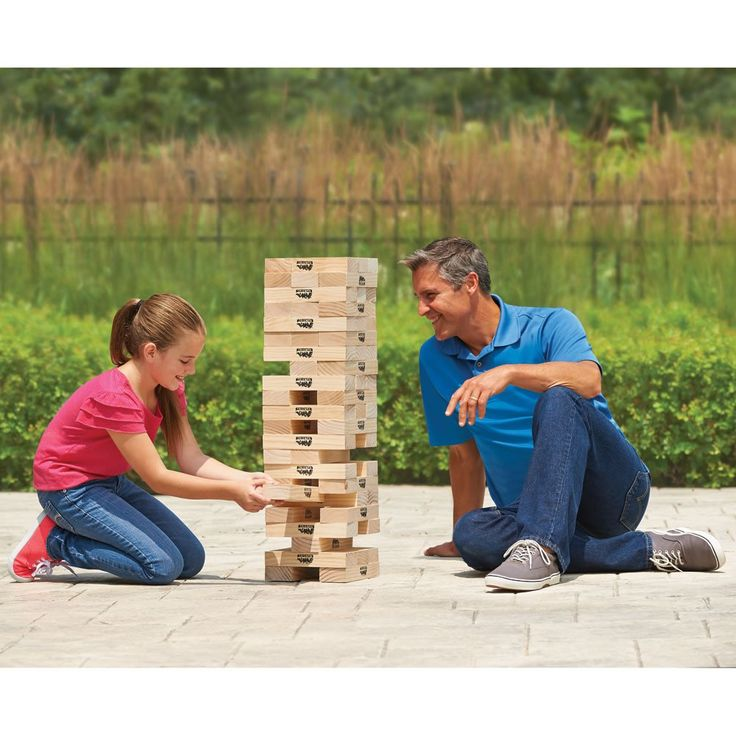 This is the wooden block set that forms a 4' tower that players must disassemble one piece at a time without toppling the whole stack. Available only from Hammacher Schlemmer, the game has 54 solid wooden pieces—about 3X larger than those used with common building block games—that start as a dense, gapless structure 2 1/4' high and can rise up to 4 1/2' into the air. Players take turns carefully removing a block while leaving the structure intact, wea...