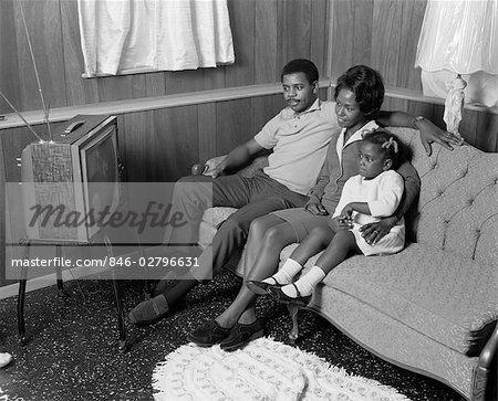 black family watching tv. 1970s african american family watching portable television mother father girl sitting on couch | jitney pinterest black family watching tv