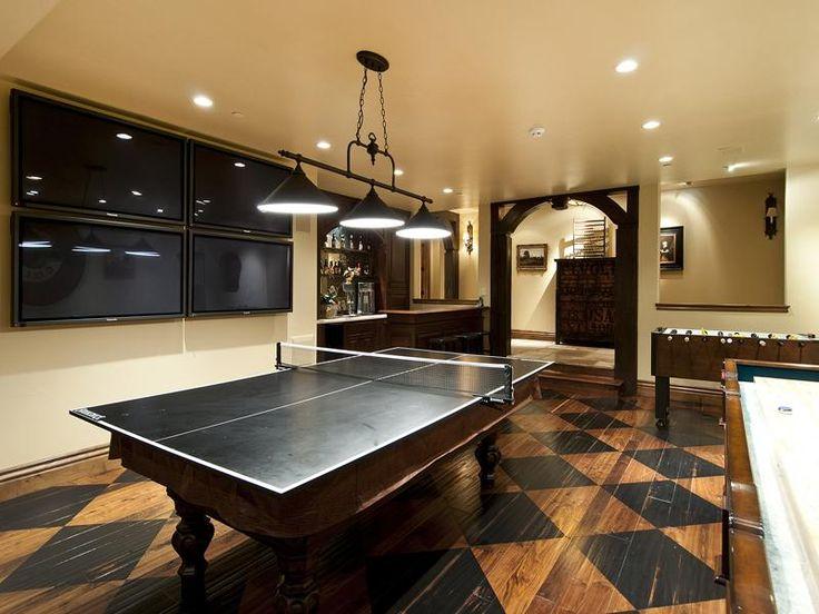 Game Room With Painted Wood Floor Shuffleboard Foosball