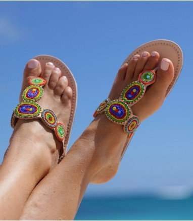 The Karembo is a stunning and unique sandal. The light natural leather makes the beautiful beads stand out. Handmade in Kenya. Thong style sandal. Genuine leather upper (dyed & sun dried) with contrasting white stitching. Flat flexible rubber sole (0.4'').