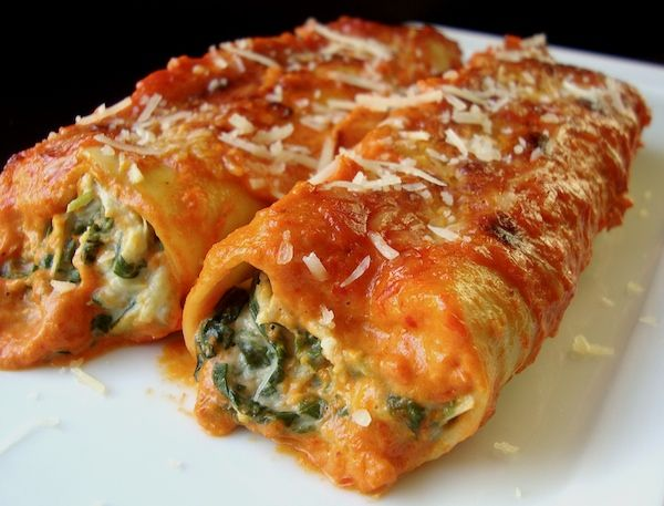 Artichoke Spinach Cannelloni With Roasted Red Pepper Sauce: if you imagine Spinnach/Artichoke Dip in a pasta rollatini with a delicious zesty pepper sauce, then this is exactly what this recipe is like. So yummy - we partially cooked dried lasagne sheets as we didn't have any fresh lasagne, but it would be fantastic with home made lasagne. Really easy to make and the red pepper sauce was absolutely fantastic. 10/10