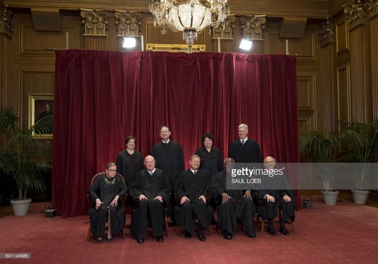 Justices of the US Supreme Court sit for their official group photo at the Supreme Court in Washington, DC, on June 1, 2017. Associate Justices Ruth Bader Ginsburg and Anthony M. Kennedy, Chief Justice of the US John G. Roberts, Associate Justices Clarence Thomas and Stephen Breyer. Standing (L-R): Associate Justices Elena Kagan, Samuel Alito Jr., Sonia Sotomayor and Neil Gorsuch. /