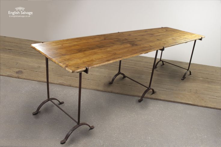 Reclaimed wooden plank table which slots on to three iron trestle legs. A large, vintage industrial piece which would look great in a restaurant or cafe.
