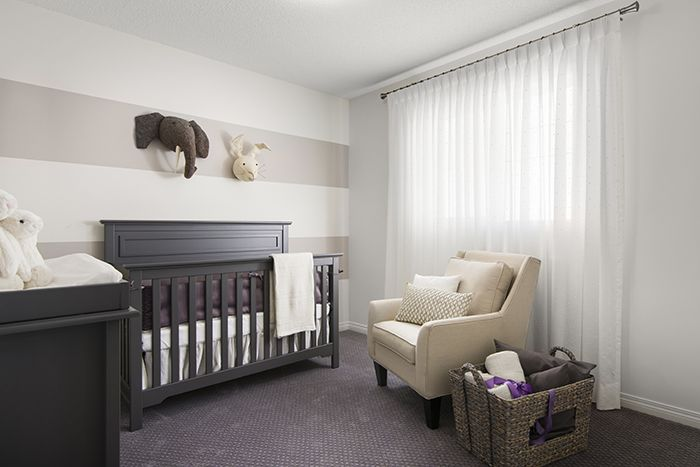 Secondary bedroom  in the Wysteria showhome in the community of Redstone in northeast Calgary