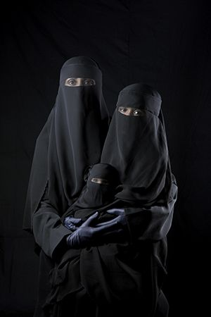 "Boushra Almutawakel's series ""Mother, Daughter, Doll"" (2000)  challenges Western conceptions of the hijab. ©BOUSHRA ALMUTAWAKEL/COURTESY HOWARD GREENBERG GALLERY, NEW YORK"