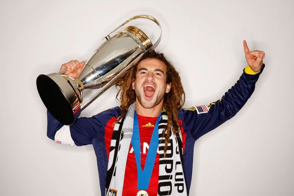 RSL Captain Kyle Beckerman holding the 2009 MLS Cup.