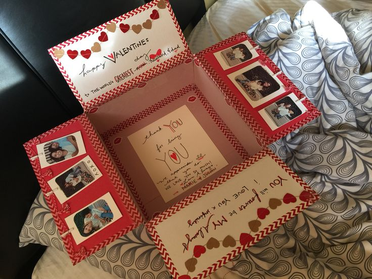 """Spruced up a large USPS priority box for my husbands Valentine's Day care package. Made the little tassel garland myself, and bought the heart garland from michaels :). Pictures were taken with my iPhone and printed out with my mini Canon """"Selphie"""" printer.  ❤️Marie A."""