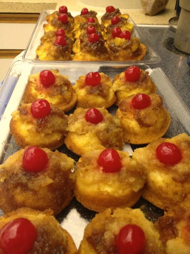 Upside-Down Pineapple Cupcakes... it's an easy recipe that uses box cake mix but seems to be made from scratch! Very impressive :)