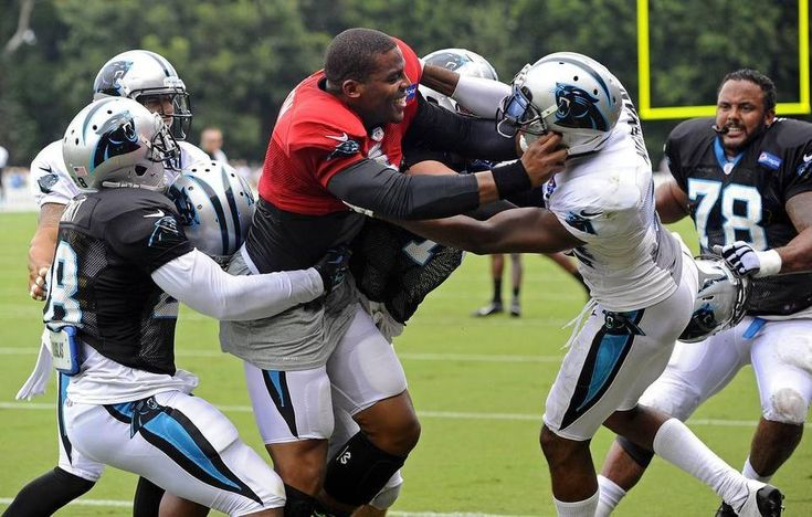 Carolina Panthers teammates work to separate Cam Newton (1) and Josh Norman (24) as the get into a skirmish in practice during Carolina Panthers Training Camp at Wofford College in Spartanburg, SC on Monday.