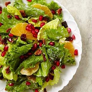 Jewel-like pomegranate seeds star along with bacon, tangy clementines and sweet dates in this mixed green salad recipe.
