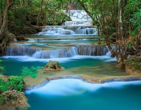 ERAWAN NATIONAL PARK AND ELEPHANT TREKKING – ON PRIVATE BASIS – TOUR DESCRIPTION. Erawan National Park is a 550 square kilometre park in western Thailand, located in the Tenasserim Hills, Kanchanaburi Province, Amphoe Si Sawat, in the Tambon Tha Kradan. Founded in 1975, it is Thailand's 12th national park. The major attraction of the park is Erawan Falls, a waterfall named after the Erawan, the three-headed white elephant of Hindu mythology. The seven-tiered falls are said to resemble the…