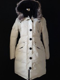 Save 71% Noize Parka, Large  This heavy winter parka is an off white colour and has an attached hood with faux fur trim, four front snap pockets/one inside pocket, ribbed knit cuffs and a front button and zipper closure.  100% polyester.  New with tags Regular retail $199.99 plus tax Our price:  $65 inclusive