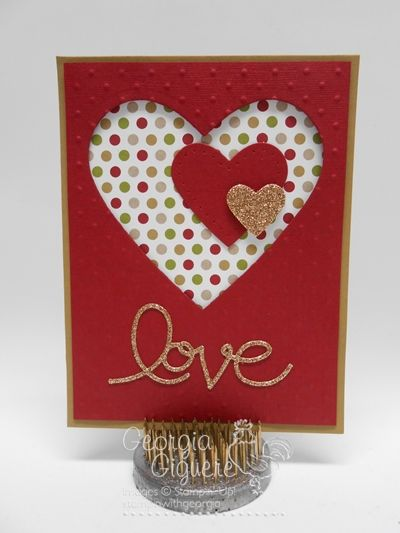 handmade card ... Expressions Valentine ... all die cuts ... negative space heart die cut filled with two more hears and  backed in colorful polka dots ... touces of gold in smallest hear and die cut LOVE ... clean lines ... like it!