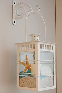 Nautical theme wall lantern...a sweet and subtle way to bring the theme into your decor...and once your over Nautical, or ready for some holiday decor, keep the lantern, but change out the accents inside!