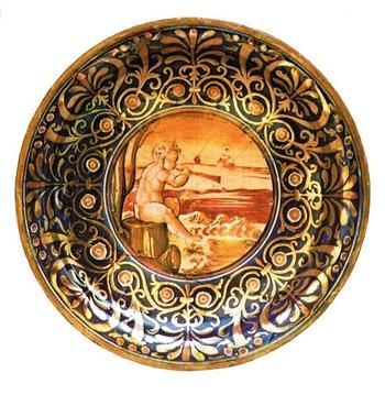 Giorgio Andreoli ~ Tondo with Music Making Putto ~  ca.1525-1530 ~ maiolica ~ once part of the Collection Ingenheim, Reisewitz ~ Galleria Barberini, Terni (1981). Current location unknown ~ Giorgio Andreoli (1465-1555), named also Mastro Giorgio Andreoli or Mastro Giorgio, was born in Intra, on the Lake Maggiore, and died in Gubbio, where he spent most of his life.
