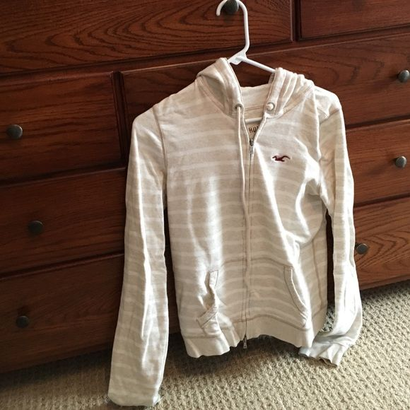 Hollister zip up hoodie Hollister light weight beige zip up hoodie. Barely worn Hollister Tops Sweatshirts & Hoodies