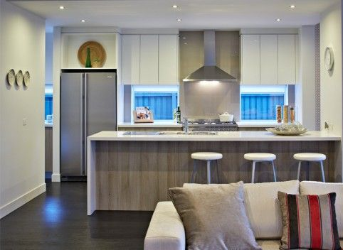 Whites, pale woods and brushed steel come together effortlessly in this modern kitchen