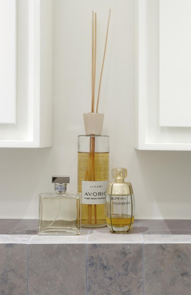 Tulikivi Atazul limestone along with perfumes. Tulikivi's media