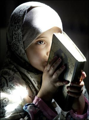 """Aziza was born under the Islam faith. Although she never been taught much she still speaks the language of the Koran, Arabic. Her surroundings influenced her to be muslim such as the Taliban, her parents, and culture. """"She has begun practicing verses form the Koran""""."""