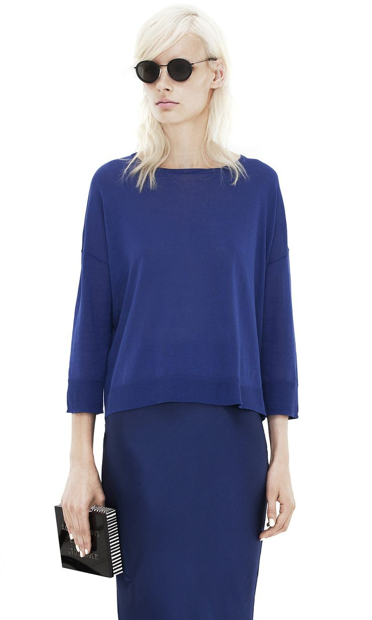 Acne // Electric blue blouse and skirt combo with sleek black accessories