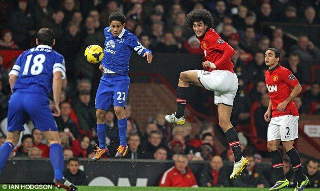 Former Everton midfielder Fellaini battles with his old team-mate Steven Pienaar