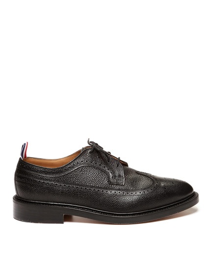 THOM BROWNE Scotch Grain Wingtips The black pebble leather gives these  wingtips added texture; the tricolor pull tab gives them a little pop.