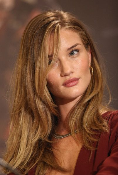 Dark blonde hair with subtle highlights, long layers. Rosie Huntington-Whitely