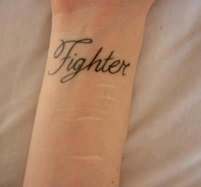 Fighter tattoo on arm idea - http://www.beautifultattooideas.com/fighter-tattoo-arm-idea/