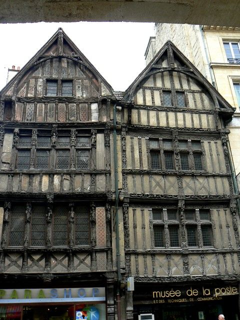 built 1510-1520, carved wood facade...