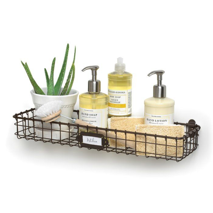 Reduce clutter and create an organized home with Spectrum's Vintage Wall Mount Tray. Store anything from lotions and soaps in the bath, spices and small jars in the kitchen, to hand gardening tools in the garage; the options are endless. A convenient label plate allows you to easily label the tray's content. Made of sturdy steel, this rustic storage bin will add the perfect amount of vintage charm to any space in the home.