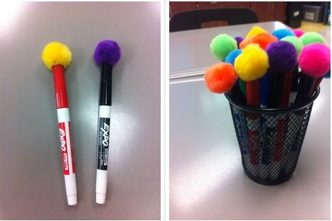 Pom poms on the caps of dry erase markers--instant erasers