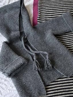 Appley Hoodie - Knit this babies hooded jacket from Easy Little Knits. Designed by Martin Storey using the wonderful soft blend yarn Wool Cotton 4ply (wool and cotton), this garter stitch jacket has an all-in-one hood and turn back cuffs.