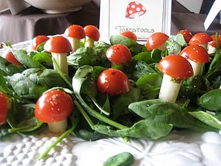 cute kiddy toadstool canapes - cherry tomatoes, mozzarella and pesto/hummus/cream cheese glue in a spinach and basil forest!