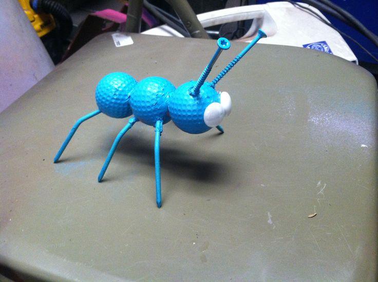 Golf ball ant yard art
