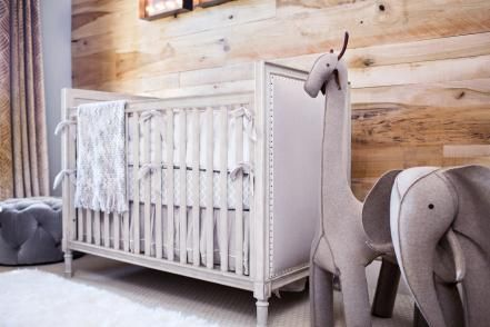 This transitional nursery from Nina Magon borders on the eclectic with its rustic wall, marquee letters and animal-themed decor.