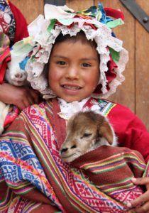 Pisac-Peru-girl-posing-with-her-lamb