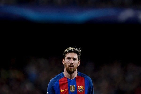 Barcelona's Argentinian forward Lionel Messi looks on during the UEFA Champions League Group C football match FC Barcelona vs Borussia Moenchengladbach at the Camp Nou stadium in Barcelona, on December 6, 2016. / AFP / JOSEP LAGO