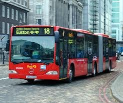 "These elongated buses are called Bendy Buses as they bend in the middle.  You can board bendy buses through any door but you must remember to ""touch in"" with your Oyster Card when you get on the bus.  If you don't and a ticket inspector asks to see your ticket, you will be fined on the spot."