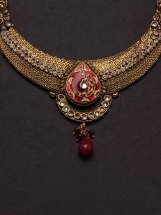 Golden  choker set in Red meenakari a and white stone