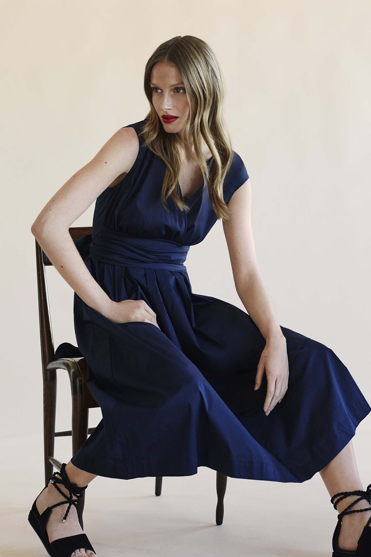 A dark blue wrap dress is perfect to wear for all your summer parties.